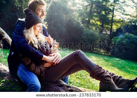 smiling couple with autumn background - stock photo
