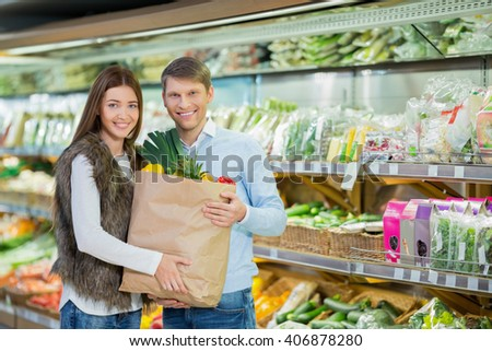 Smiling couple with bags  - stock photo