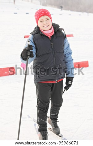 Smiling cross-country skier in winter day