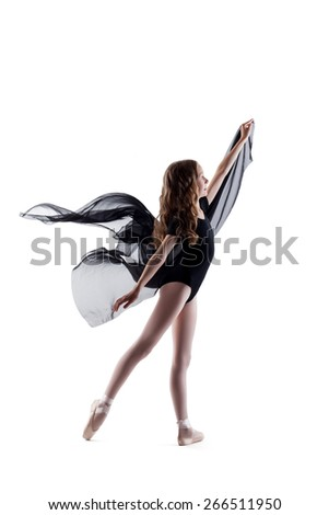 Smiling curly ballerina dancing with cloth - stock photo