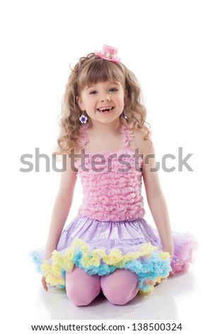 Smiling curly girl posing in candy costume