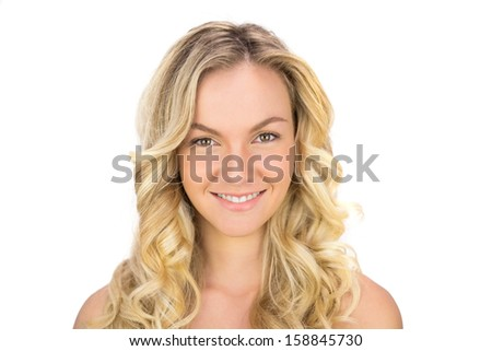 Smiling curly haired blonde posing on white background - stock photo