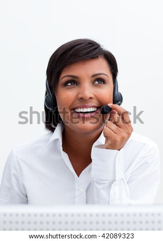 Smiling customer service agent with headset on against white background - stock photo