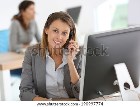Smiling customer service representative at work - stock photo