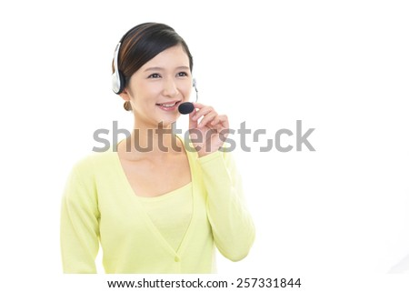 Smiling customer services operator - stock photo