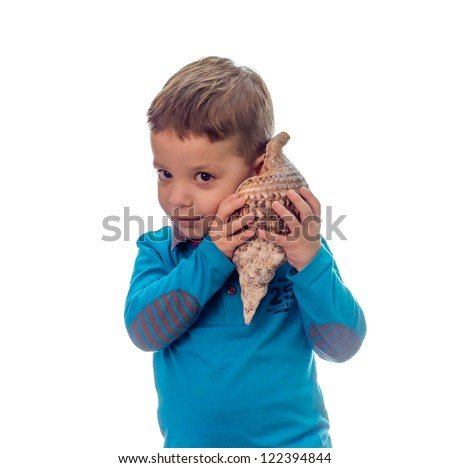 Smiling cute boy listening to the sea through a seashell on white background - stock photo