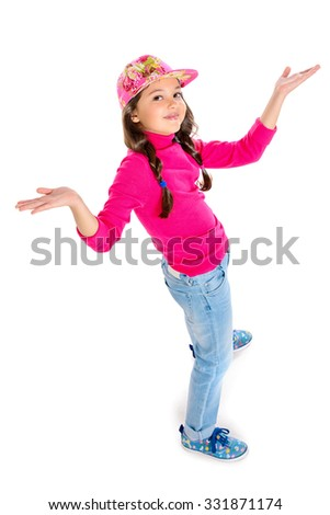 Smiling cute eight-year girl in casual clothes looking at camera. Top view. Isolated over white. - stock photo