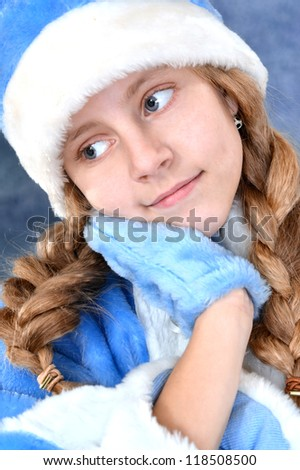smiling cute girl in a blue on blue