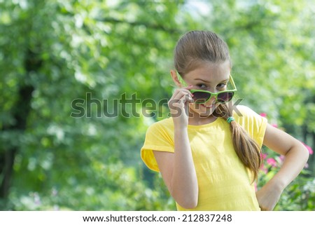 smiling cute little girl in glasses - stock photo
