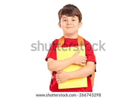 Smiling cute schoolboy with backpack holding books and looking at camera isolated on white background - stock photo