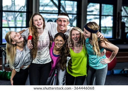 Smiling dancer group posing together in the gym - stock photo