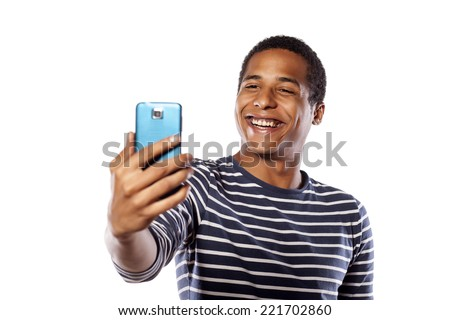 Smiling dark-skinned young man making selfie on white background - stock photo