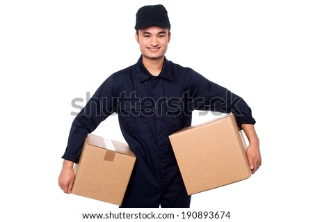 Smiling delivery man carrying two parcel boxes - stock photo