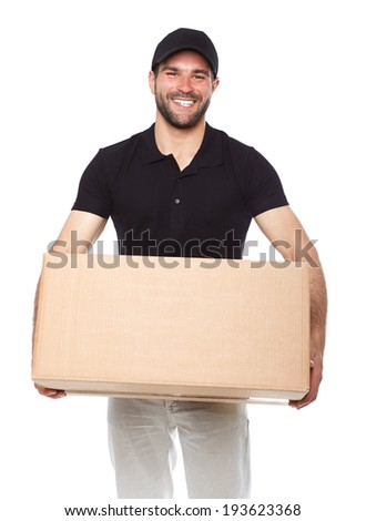 Smiling delivery man giving cardbox on white background - stock photo
