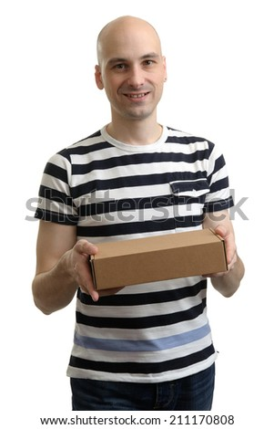 Smiling delivery man holding the box over white background - stock photo