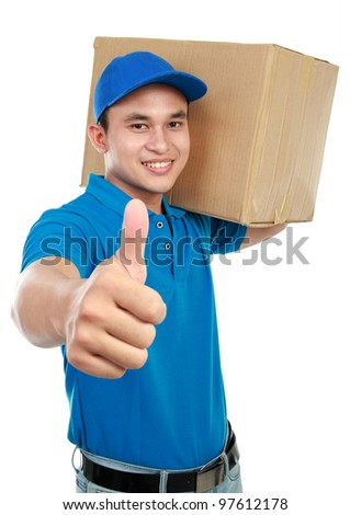 smiling delivery man in blue uniform carrying packages while gesturing thumb up sign isolated on white background - stock photo