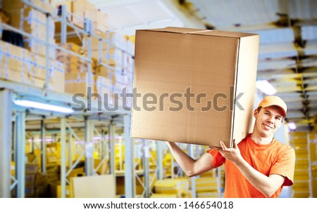 smiling delivery man in classic warehouse delivery gay with parcel in warehouse 3d background - stock photo