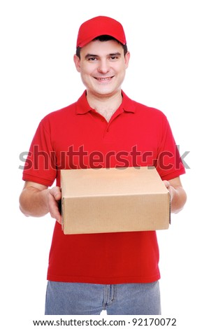 Smiling delivery man in red uniform holding the box over the white background