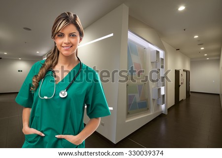 Smiling Doctor at Hospital - stock photo