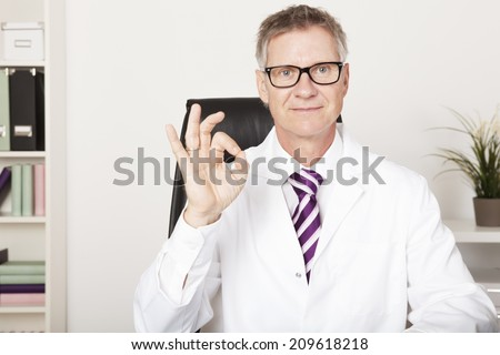 Smiling Doctor Showing Okay Hand Sign Emphasizing Positive Updates - stock photo
