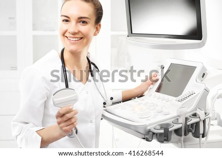 Smiling doctor, ultrasound. The doctor performed an ultrasound.  - stock photo