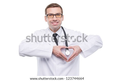 Smiling doctor with heart gesture. Isolated over a white background - stock photo