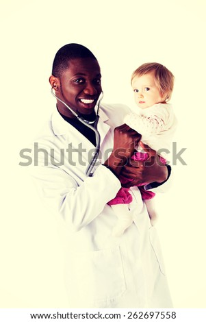Smiling doctor with small baby girl - stock photo