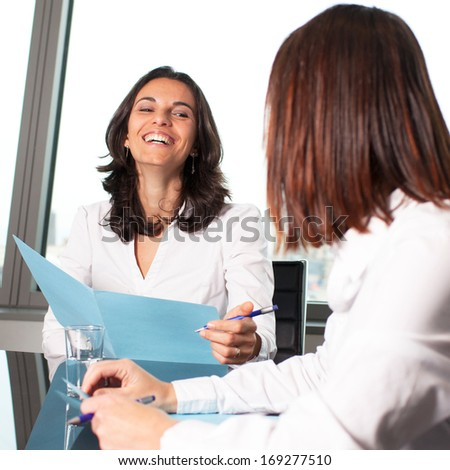 smiling during meeting in conference room - stock photo