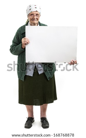 Smiling elderly lady holding blank sheet in hands over white - stock photo