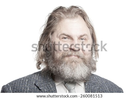 Smiling elderly man in a suit with long hair and beard