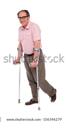 Smiling elderly man with crutches over white background