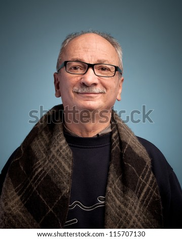 Smiling elderly man with glasses - stock photo