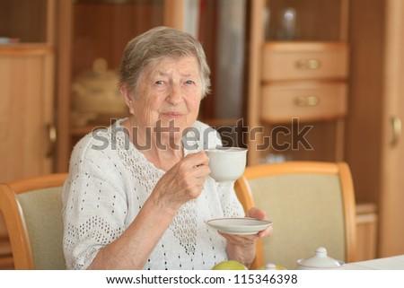 Smiling elderly woman - stock photo