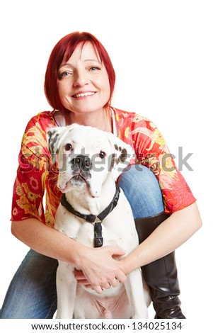Smiling elderly woman embracing a young boxer dog - stock photo