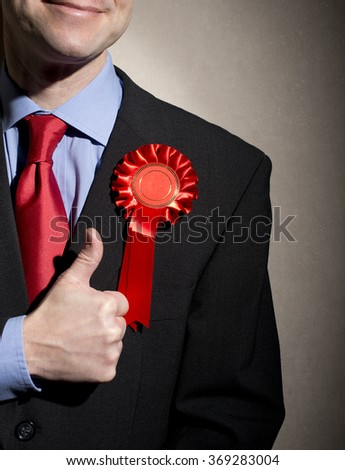 Smiling Election Candidate With Thumbs Up Hand Gesture - stock photo