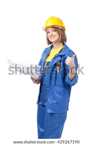 smiling engineer or architect female in yellow helmet and blue workwear with blueprints showing thumb up sign isolated on white background. proposing service. advertisement gesture - stock photo