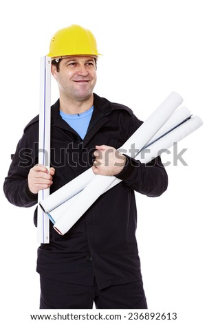 smiling engineer with rolls of paper in hand
