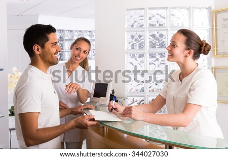 Smiling european man patient visiting medical clinic - stock photo