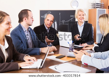 Smiling European people during conference call indoors