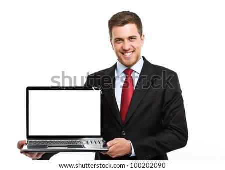 Smiling executive holding a laptop. Isolated on white - stock photo