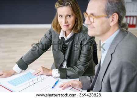 smiling experienced businesswoman in a meeting looking at the camera