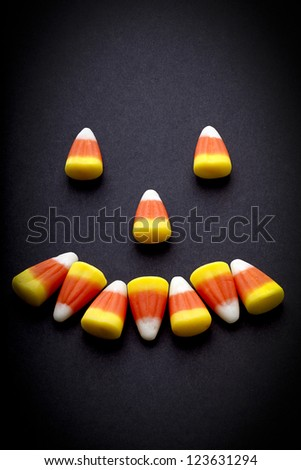 Smiling face created from candy corn. - stock photo