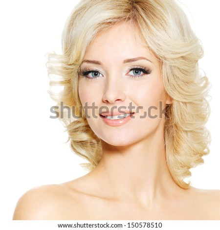 Smiling face of an young blonde pretty woman, on white background - stock photo