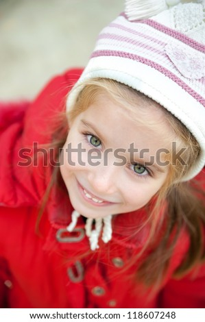 Smiling face of little girl outdoor - stock photo