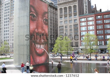 Smiling face on Chicago's Crown Fountain in Millennium Park - stock photo