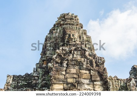 Smiling faces of the Bayon, Khmer temple at Angkor in Cambodia. Official state temple of the Mahayana Buddhist King Jayavarman VII - stock photo