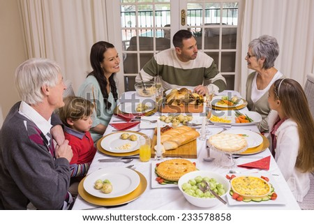 Smiling family at christmas time at home in the living room - stock photo