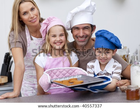 Smiling family baking cookies in the kitchen