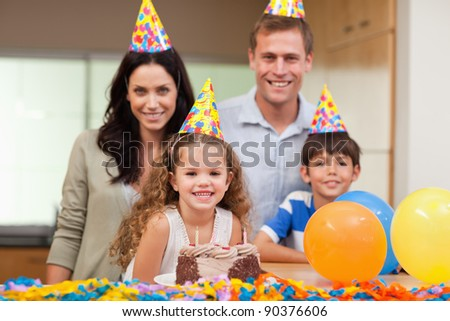 Smiling family celebrating birthday together
