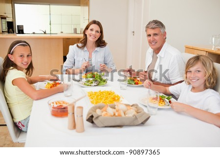 Smiling family having dinner together